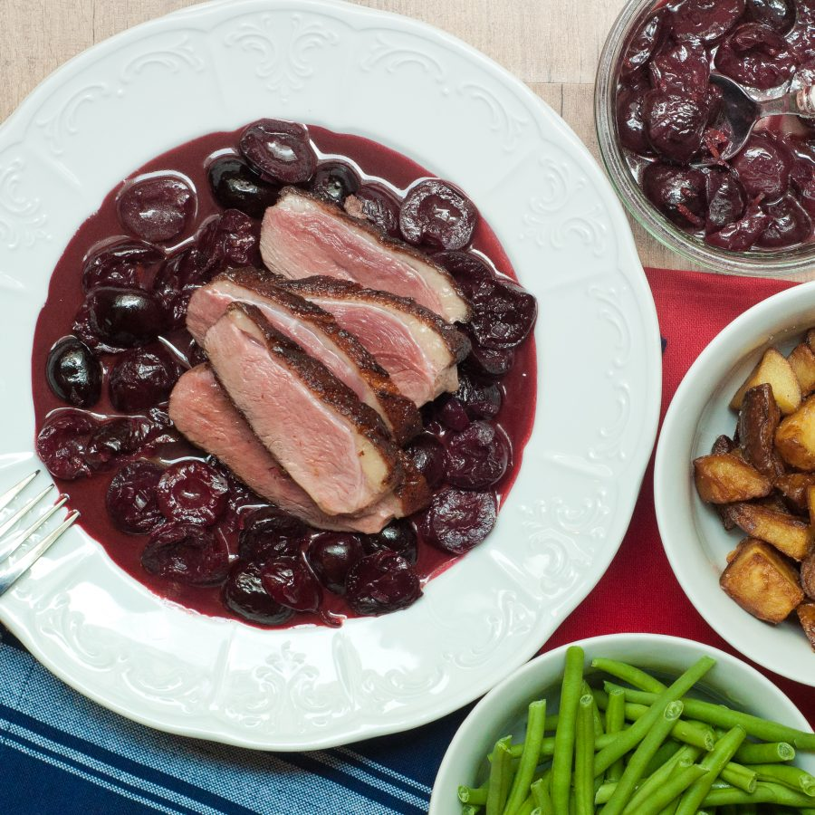 Duck with a red wine cherry sauce by Mardi Michels