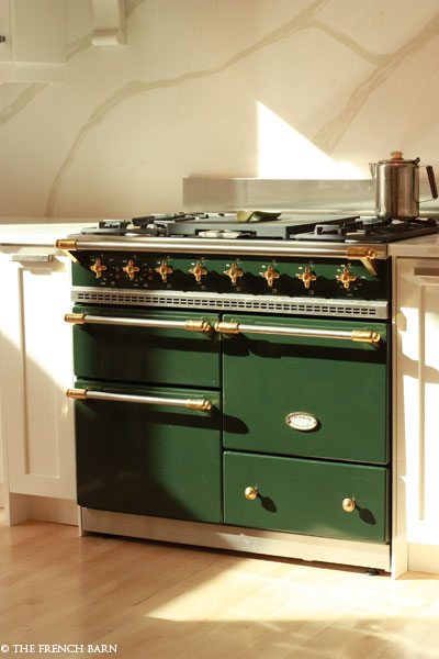 Dark Green stove in kitchen filled with light