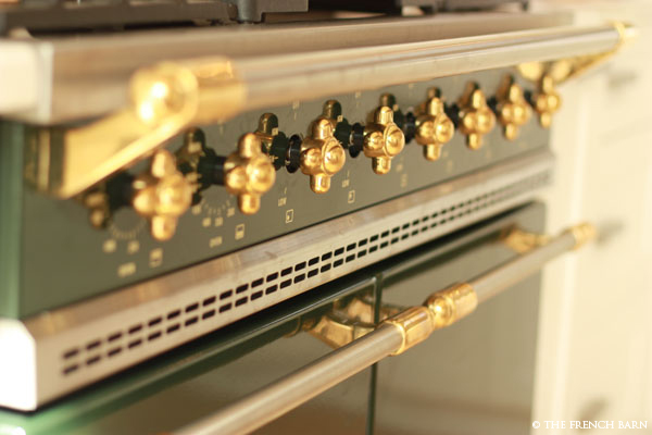 Close-up of Lacanche brass knobs