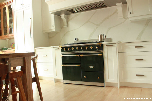 Hardwood floors with green stove