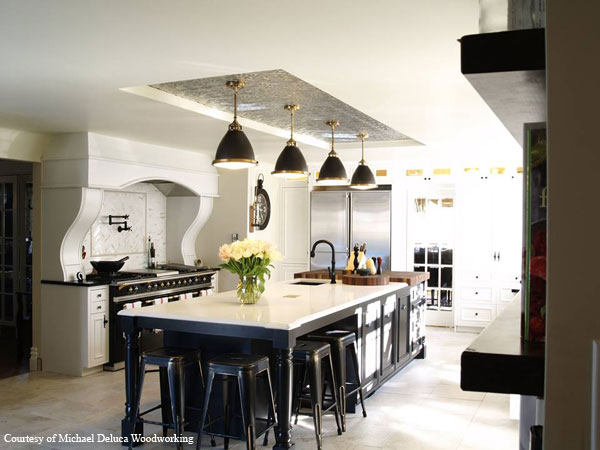 Large kitchen with Black and Brass chandeliers